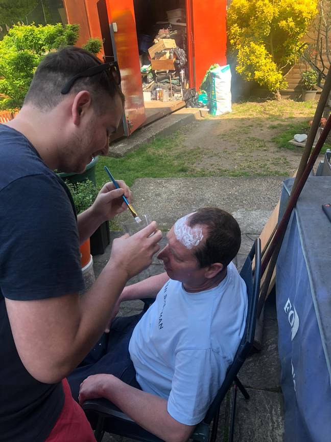Nick used glue to stick his trimmings onto his dad's head. Credit: LADbible