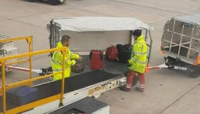 Baggage handlers carelessly fling suitcases onto a cart. Credit: Newsflare