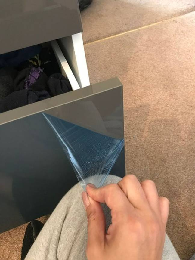 Kayleigh realised that it was actually a protective film covering the cabinet. Credit: Kennedy News
