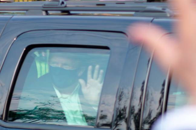 Trump left hospital briefly to wave to fans. Credit: PA