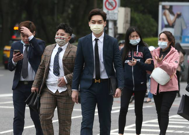 People wearing face coverings to curb the spread of Covid-19 in Taipei, Taiwan. Credit: PA