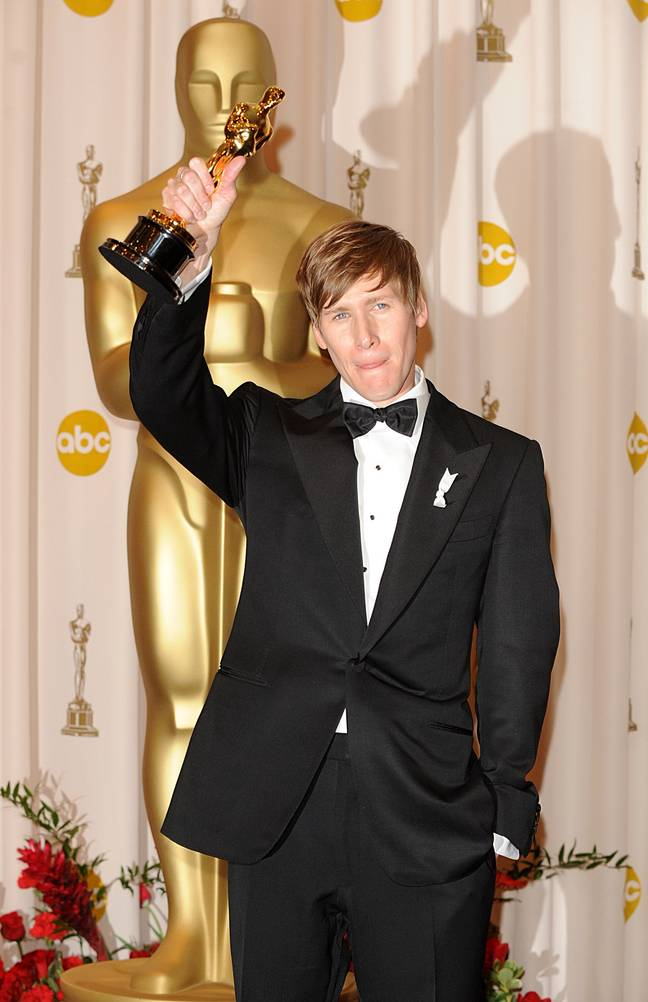 Dustin Lance Black with the Best Original Screenplay award, received for Milk, at the 81st Academy Awards. (Credit: PA)
