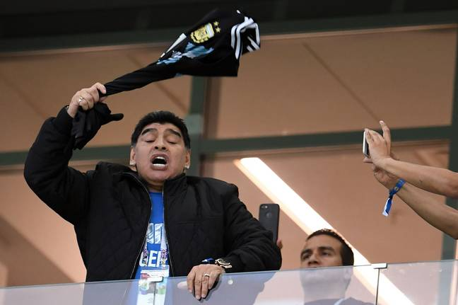 Maradona waves a Messi shirt. Image: PA