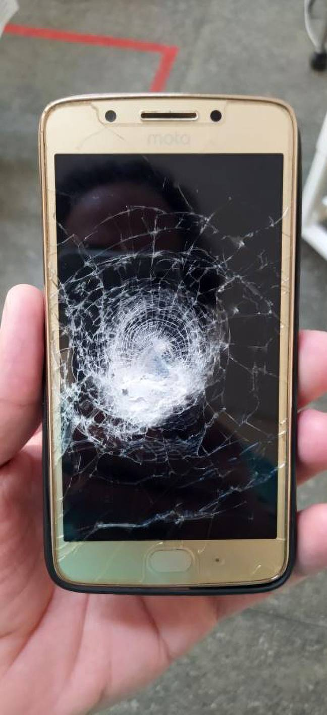 The smartphone took the deadly force of the bullet. Credit: Newsflash