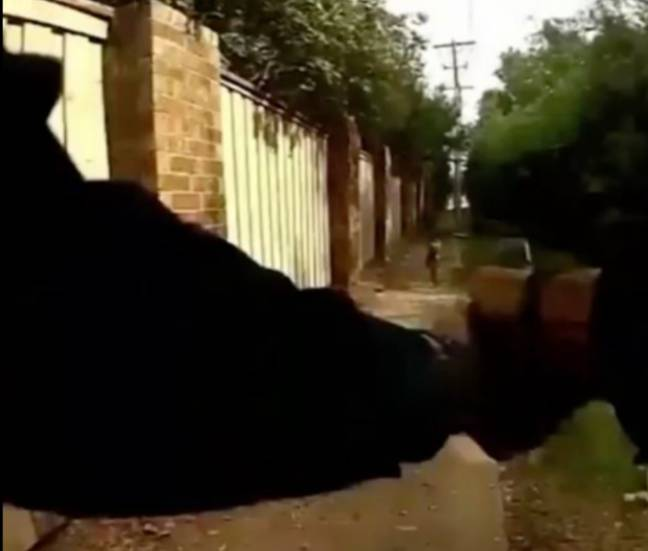 Bodycam footage shows the officer firing his gun. Credit: Arlington Police
