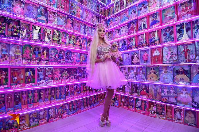Tatiana surrounded by Barbie dolls. Credit: East2West News