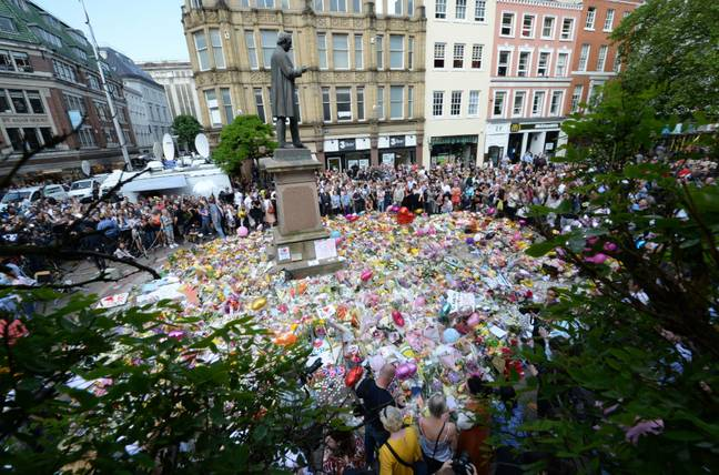 Tributes in St Ann's Square, Manchester. Credit: PA