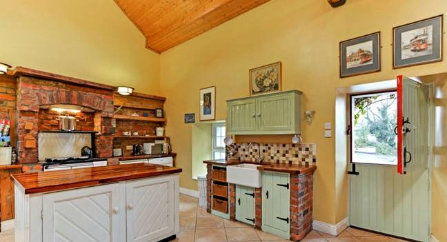 The house boasts a traditional kitchen. Credit: Ronan