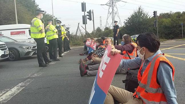 Insulate Britain protesters on the M25 yesterday. Credit: PA