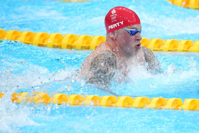 Adam Peaty competing in the men's 100m breaststroke at the Tokyo 2020 Olympics (Credit: PA)