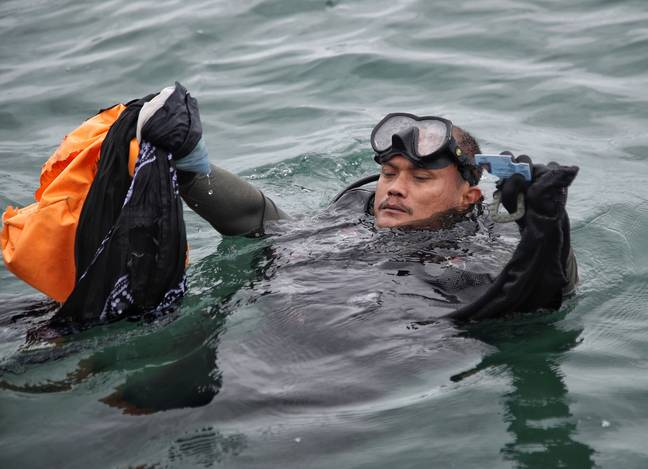 Divers have found wreckage and body parts at the crash site. Credit: PA