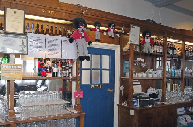 Chris and his wife have 15 Gollywog dolls behind the bar. Credit: Eastnews Press Agency