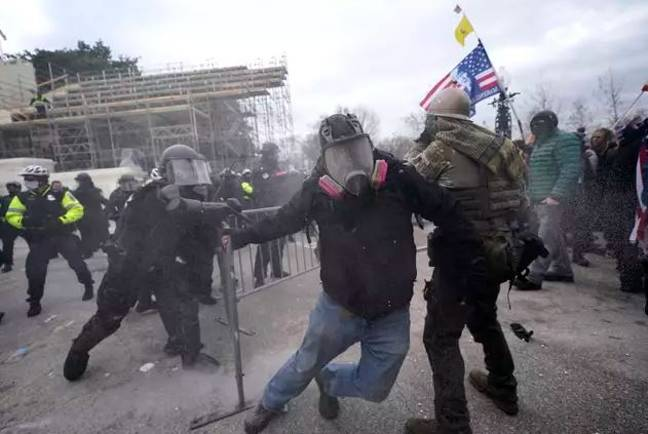 The riots taking place at the Capitol. Credit: PA