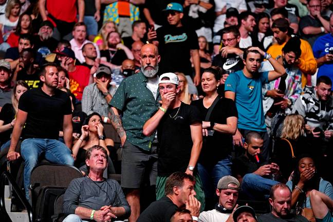 Fans react after seeing Weidman's leg break. Credit: PA