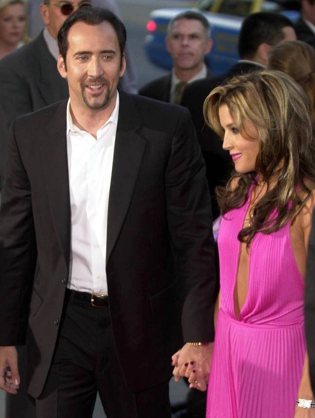 Cage with Lisa Marie Presley in 2001. Credit: PA