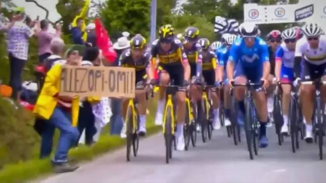 A fan holding a sign caused a massive pile-up in stage one of the Tour de France. Credit: Twitter/Eurosport