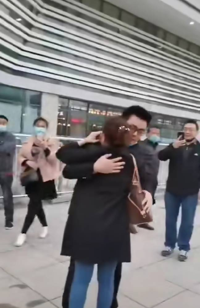 Ms Xu meets her biological son for the first time. Credit: AsiaWire