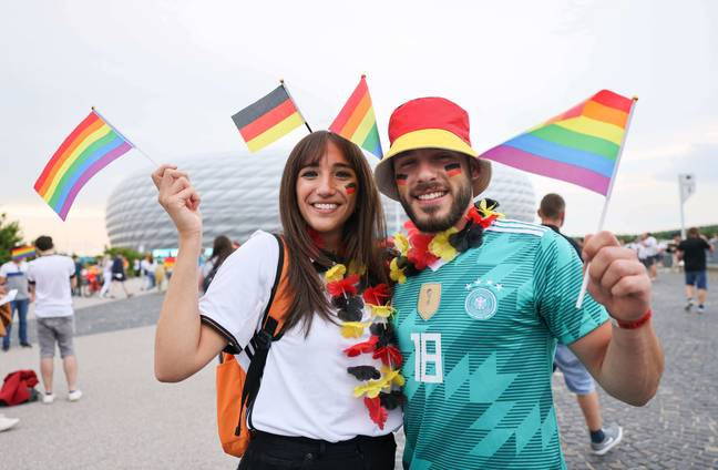 Many fans are flying rainbow flags at the game. Credit: PA