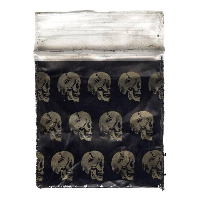 Gold skull drug baggie