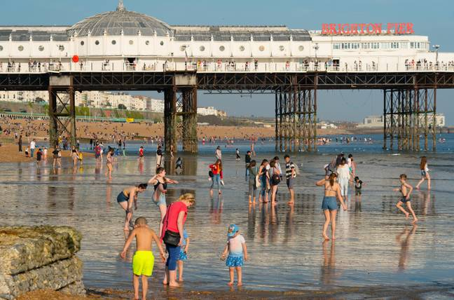 People enjoying the warm weather in Brighton. Credit: PA