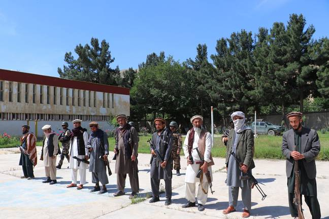 Taliban militants attend a surrender ceremony in Pul-e-Khumri, capital of Baghlan province, Afghanistan. Credit: PA