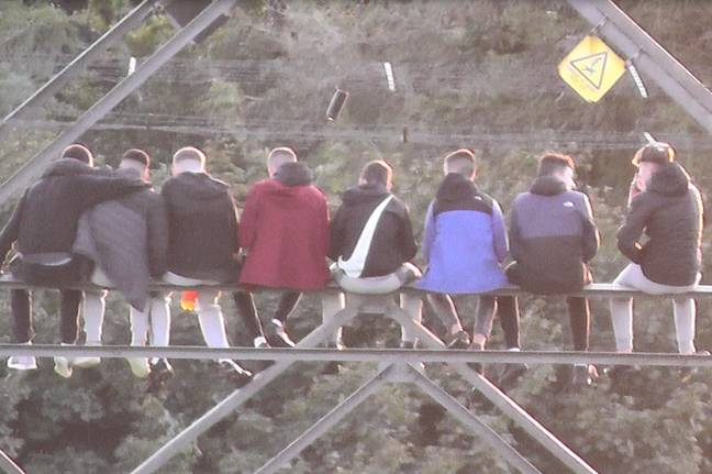 The teens gathered on a pylon. Credit: Belfast Live