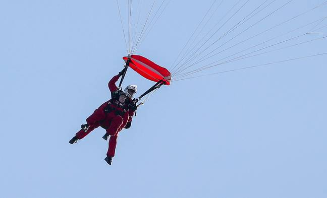 Sandy jumped with a parachutist from the Army's Red Devils. Credit: PA