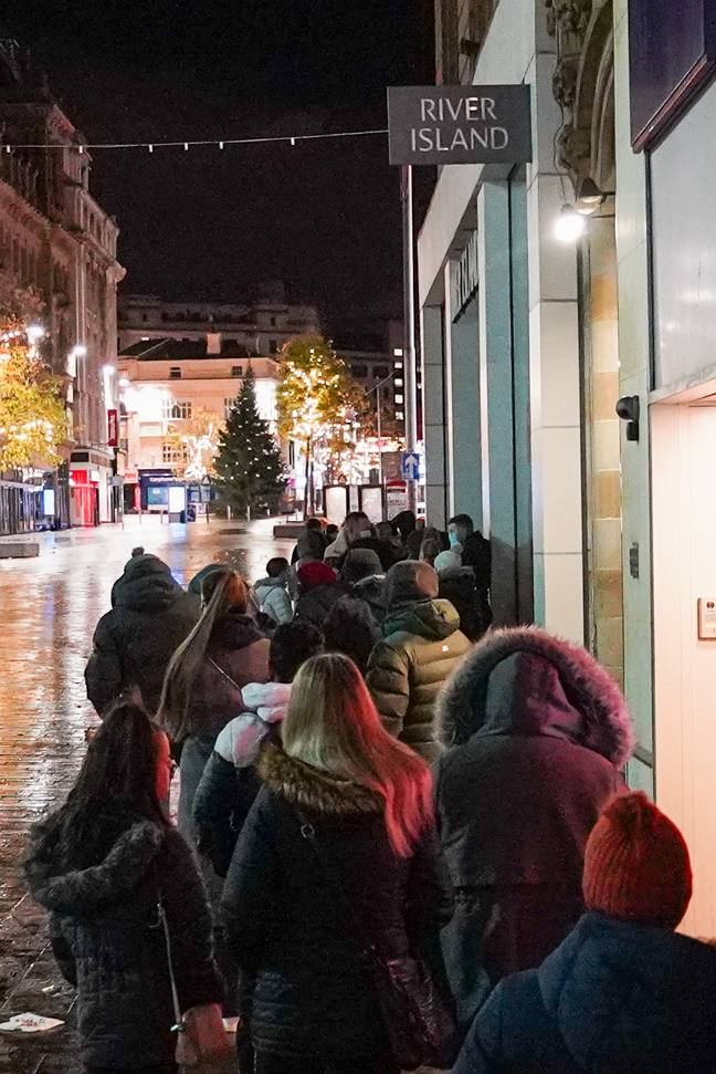Shoppers queuing in Liverpool. Credit: London News Pictures (www.londonnewspictures.co.uk)