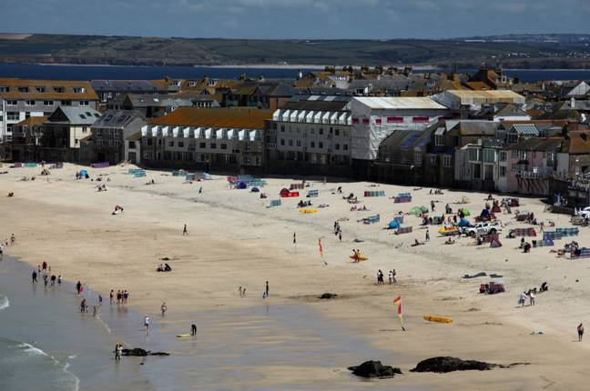 Porthmeor Beach... without the encampment of tents. Credit: SWNS