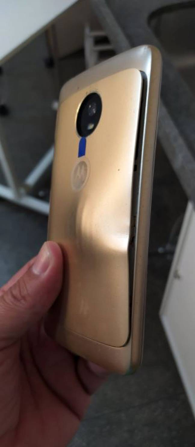 The bullet miraculously left the smartphone with nothing but a smashed screen and a visible dent. Credit: Newsflash