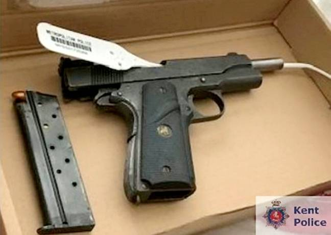 A loaded gun was discovered in his flat. Credit: SWNS