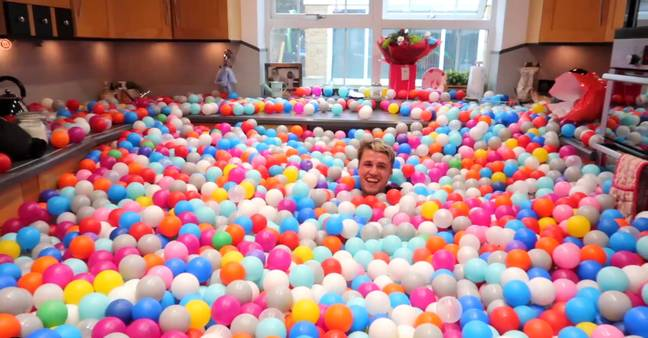 The kitchen submerged in balls. Credit: SWNS