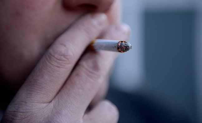 Stubbing out a cigarette