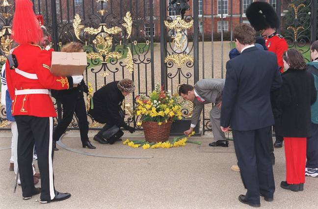 Paul Burrell laying flowers brought by children from a Cardiff hospital. Credit: PA