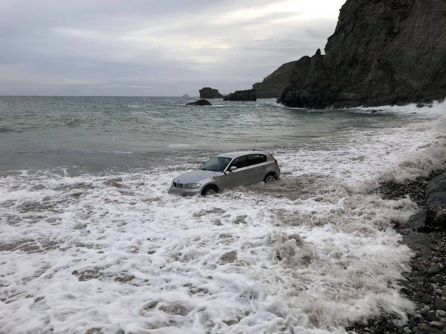 The car became trapped on St Agnes beach in Cornwall. Credit: SWNS