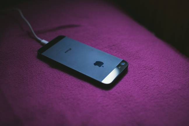 Stock image of a phone charging. Credit: Flickr/freestocks.org