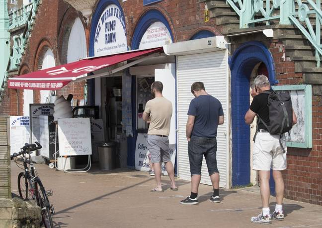 People in Brighton queuing up for ice cream. Credit: i-Images Picture Agency