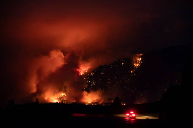 A fire rages in Lytton, Canada. Credit: PA