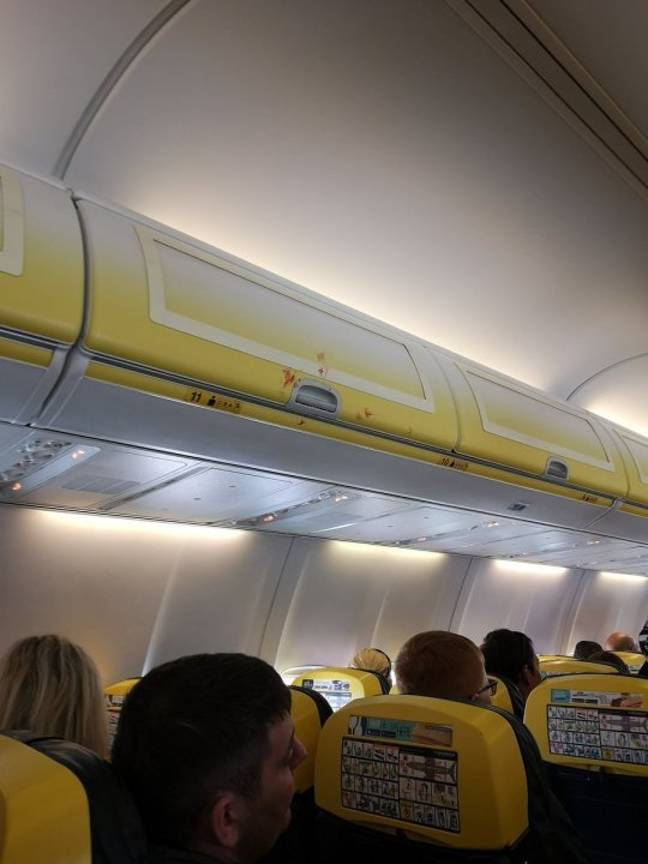 Pictures taken in the aftermath of the fight appear to show bloodstains on the plane's overhead luggage compartments. Credit: PA