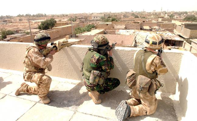 Unnamed British soldiers securing a stronghold in Basra, Kuwait. Credit: PA