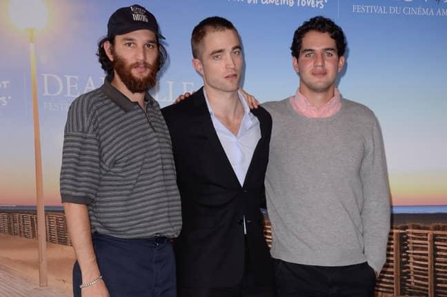 Robert Pattinson with Josh and Benny Safdie. Credit: PA