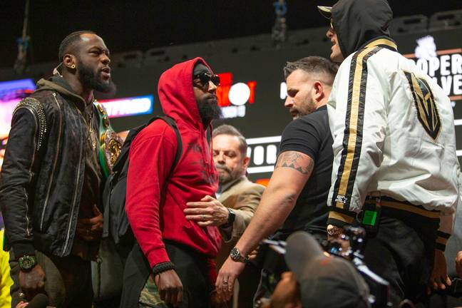 Deontay Wilder and Tyson Fury square off. Credit: PA