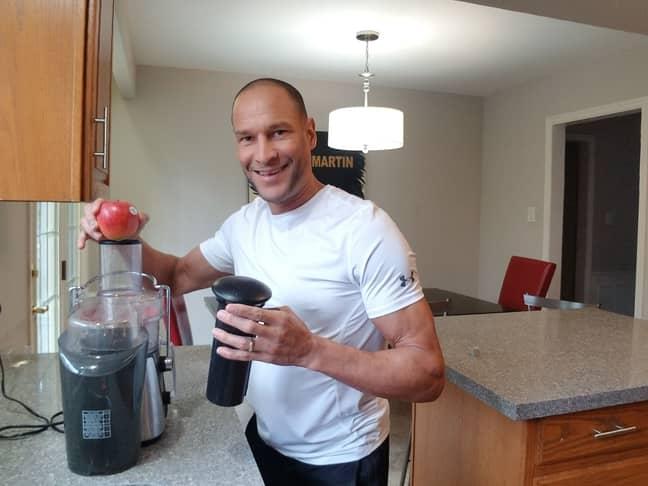 John DePass, 46, preparing fruit juice as part his regime. Credit: Kennedy News and Media