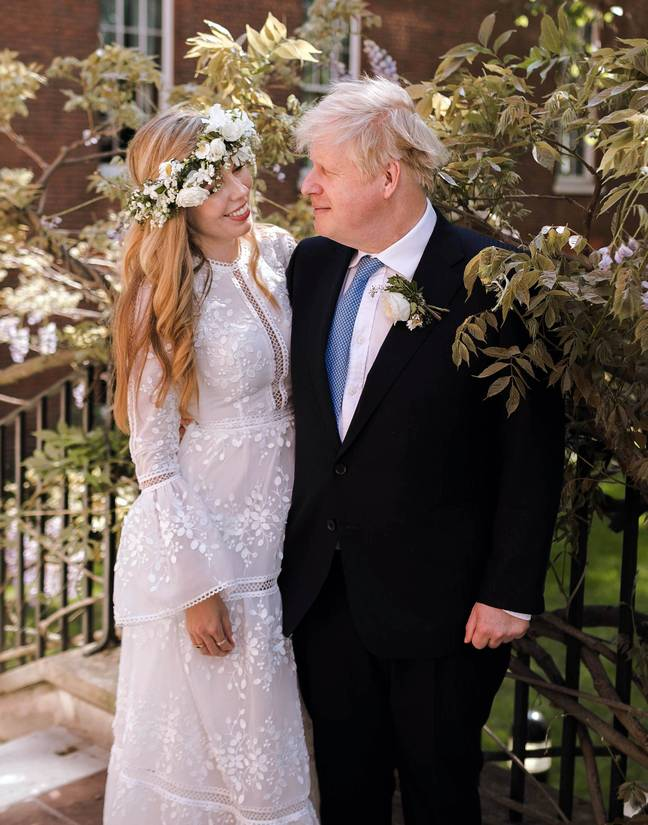 Prime Minister Boris Johnson and Carrie Johnson in the garden after their wedding. Credit: PA