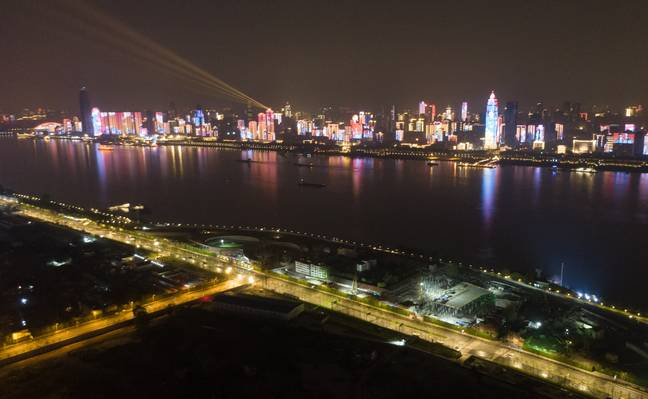 Aerial photo taken on 8 April, 2020 shows illuminated buildings in Wuhan. Credit: PA