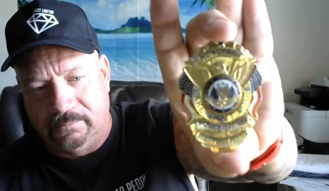 Larry showing off his cop badge. Credit: LADbible