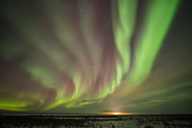 Bands of Northern Lights in the skies near Churchill in Manitoba, Canada. Credit: PA