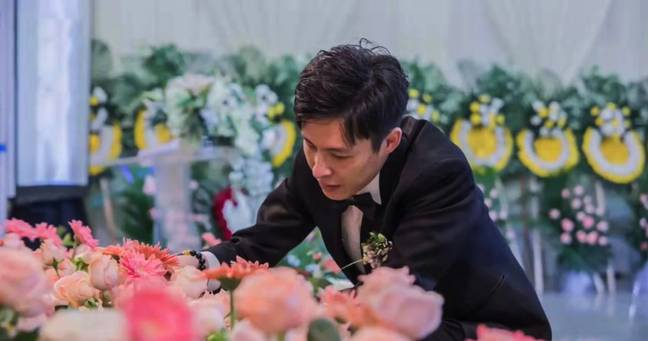 Xu Shinan stayed with his dead partner's body 24 hours a day for a week after she died. Credit: AsiaWire