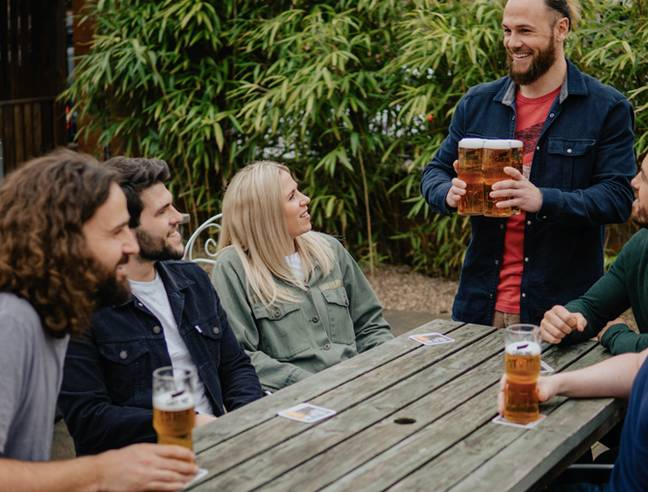 Carling's new interlocking glasses make it easy to carry four pints at once. Credit: Carling