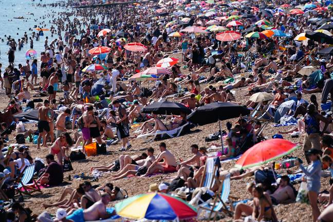 People enjoying the hot weather in Brighton on Sunday. Credit: PA